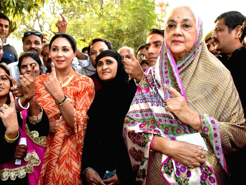 BJP MLA Diya Kumari and her mother Rajmata Padmini Devi show their inked fingers after casting their votes for Rajasthan Assembly elections in Jaipur, on Dec 7, 2018.