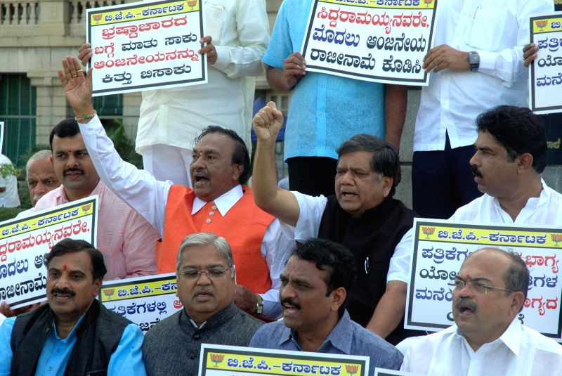 BJP MLAs and MLCs demonstration against the dismissal of tainted Social welfare Minister H Anjaneya in front of Vidhana Soudha in Bengaluru on Nov 27, 2015. - H Anjaneya