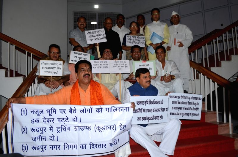BJP MLAs stage a demonstration to press for their various demands on the first day of special budget session at Uttarakhand Assembly in Dehradun, on July 21, 2016.