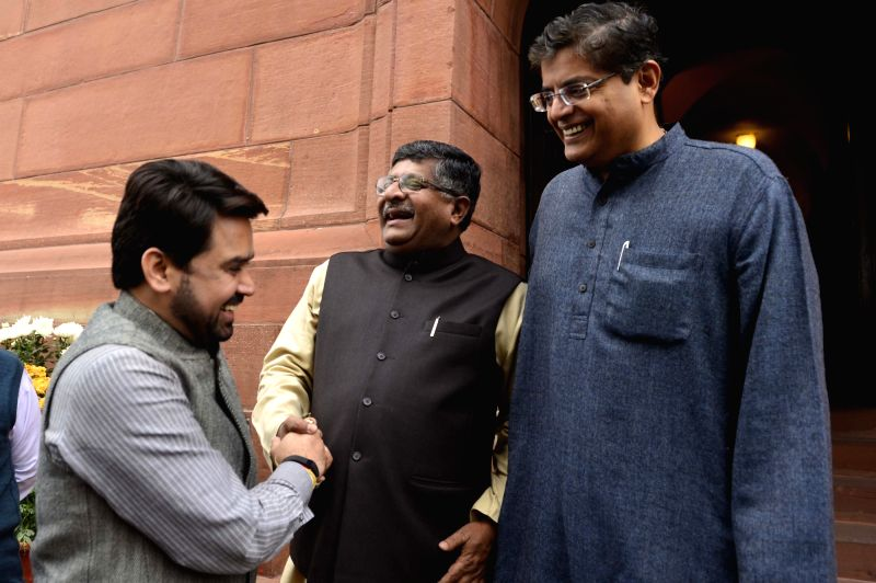 BJP MP Anurag Thakur and Union Telecom Minister Ravi Shankar Prasad at the Parliament in New Delhi, on Dec 9, 2015. - Ravi Shankar Prasad