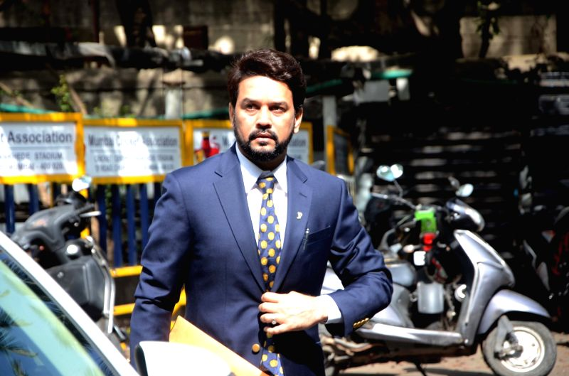 BJP MP Anurag Thakur arrives to attend the special general meeting of the Board of Cricket for Control in India (BCCI) where he was elected as the Indian cricket board's youngest president in ...