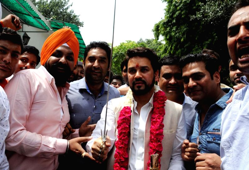BJP MP Anurag Thakur celebrates after being elected BCCI president at his residence in New Delhi on May 23, 2016.