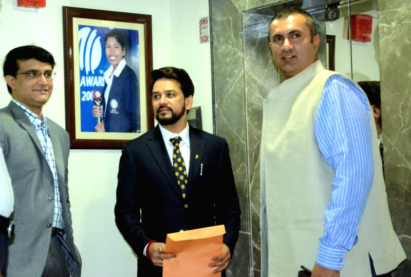 BJP MP Anurag Thakur with Cricket Association Of Bengal (CAB) president Sourav Ganguly and BCCI treasurer Anirudh Chaudhary during the special general meeting of the Board of Cricket for ... - Sourav Ganguly and Anirudh Chaudhary