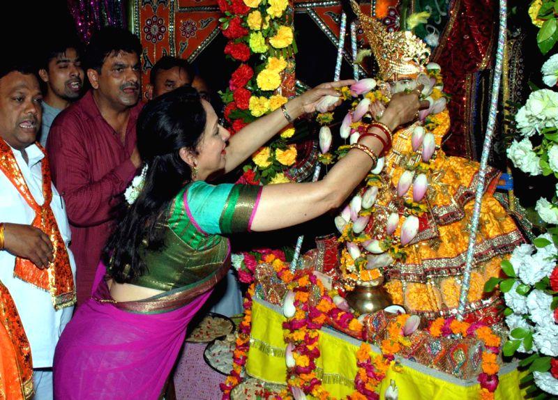 BJP MP from Mathura, actress Hema Malini worships lord Krishna on Janmashtami at a temple  in Mathura on Aug 18, 2014.