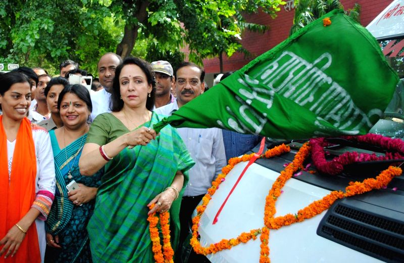 BJP MP from Mathura Hema Malini flags off a fleet of ambulances in Mathura on Aug. 6, 2016. - Hema Malini