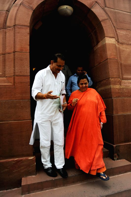 BJP MP from Saran (Bihar) Rajiv Pratap Rudy and Union Minister for Water Resources, River Development and Ganga Rejuvenation Uma Bharati at the Parliament in New Delhi on Aug 14, 2014.