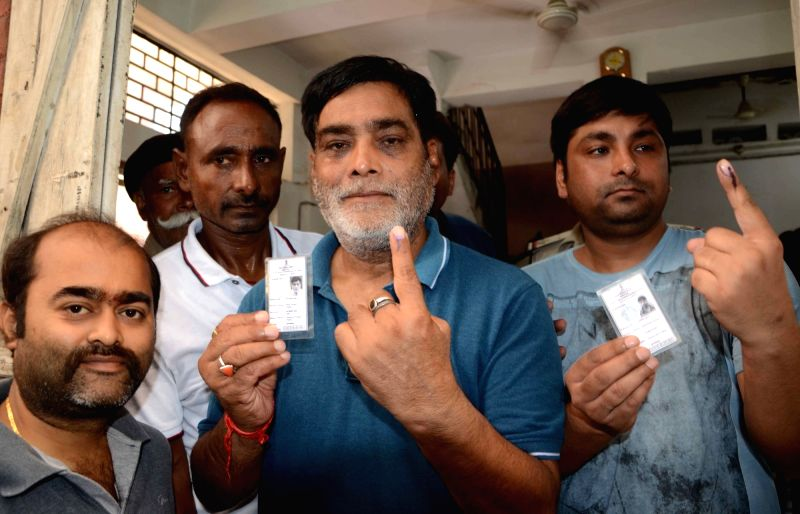 BJP MP Ram Kripal Yadav shows his forefinger marked with phosphorous ink after casting vote during Patna Municipal Corporation elections on June 4, 2017. - Kripal Yadav