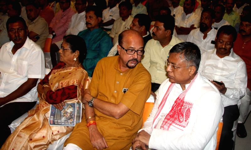 BJP MP Ramen Deka with party leader  Siddhartha Bhattacharya during BJP legislative party meeting in Guwahati, on May 22, 2016.