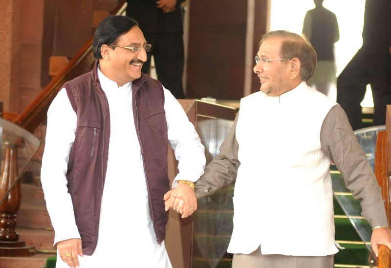 BJP MP Ramesh Nishank Pokhriyal and JD(U) chief Sharad Yadav at the Parliament in New Delhi, on Nov 27, 2014. - Sharad Yadav