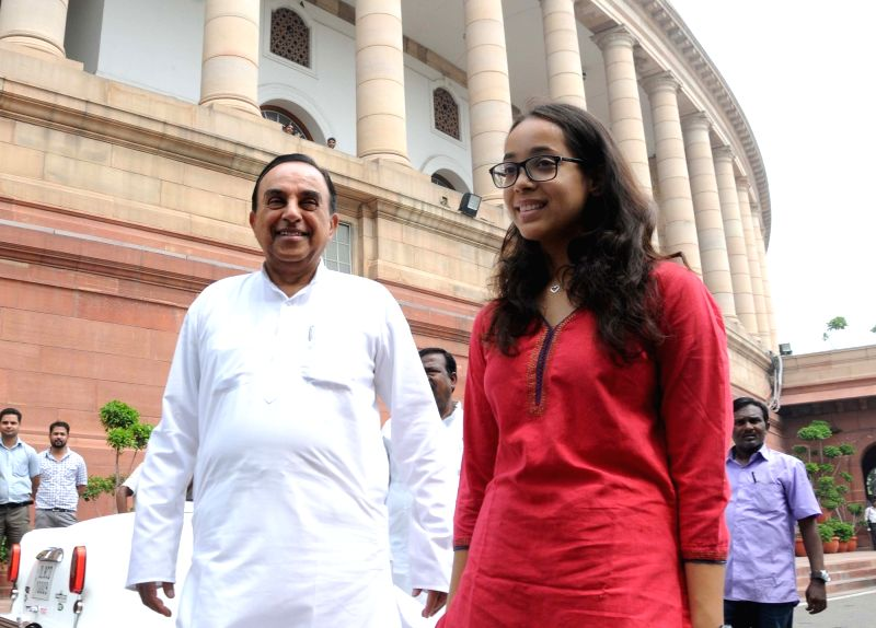 BJP MP Subramanian Swamy with grand daughter at Parliament in New Delhi, on July 26, 2016.