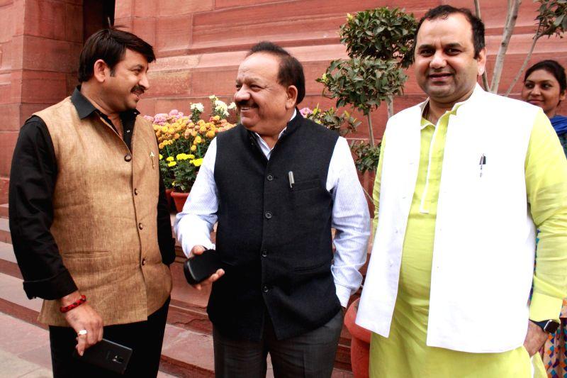 BJP MPs Manoj Tiwari, Mahesh Giri with Union Minister Dr Harsh Vardhan  at the Parliament in New Delhi, on Dec 10, 2015. - D