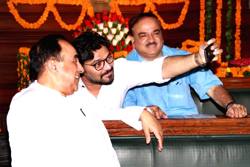 BJP MPs Subramanian Swamy, Babul Supriyo and Ananth Kumar take selfies during Ravindra Jayanti celebrations at the Central Hall of Parliament House on May 8, 2017. - Ananth Kumar