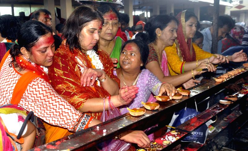 BJP National Mohila Morcha President and MP Saroj Pandey lighting earthen saki at Kamakhya temple on the eve of Ambubachi mela 2014 in Guwahati on June 21, 2014.