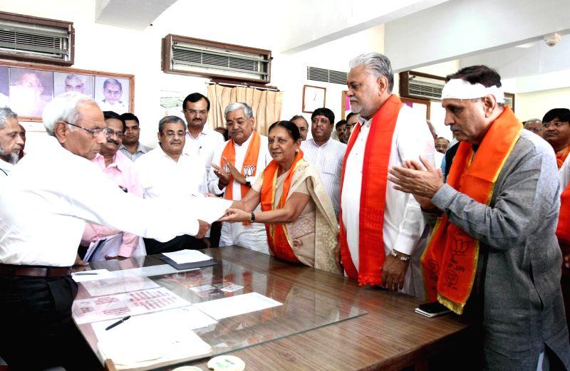 BJP National Vice President Purushottam Rupala files his nomination papers for Rajya Sabha elections at Gujarat assembly in Gandhinagar on May 30, 2016. Also seen Gujarat Chief Minister ... - Anandiben Patel