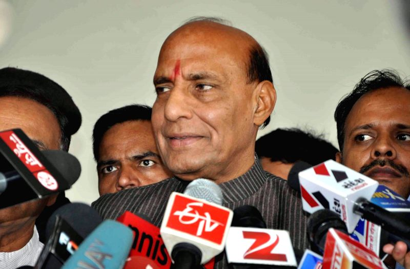 BJP president Rajnath Singh addresses press after meeting top BJP leaders in Gandhinagar on May 14, 2014. - Rajnath Singh