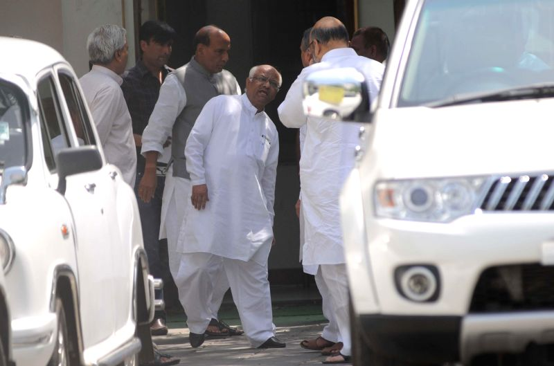 BJP president Rajnath Singh with party leader Amit Shah after a meeting at his residence in New Delhi on May 15, 2014.