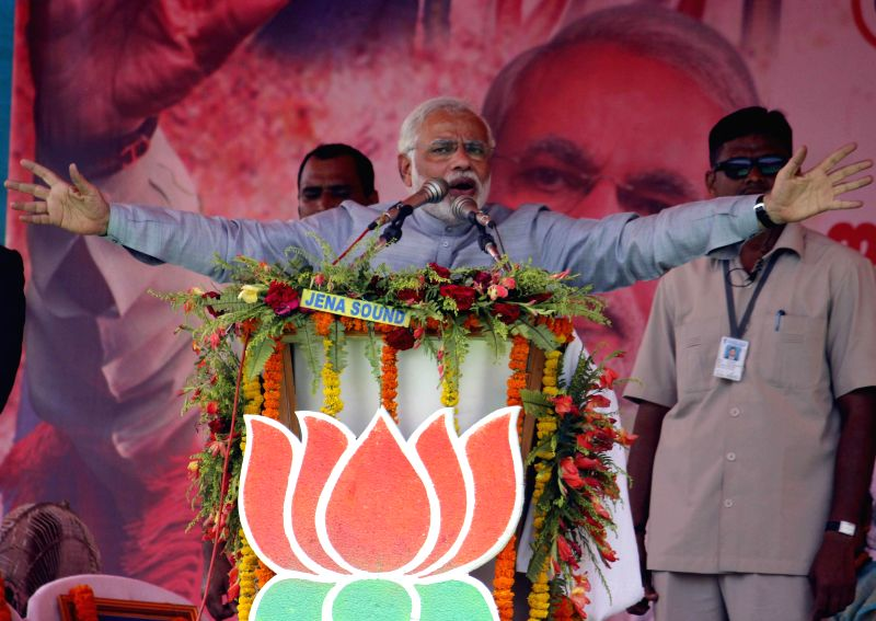 BJP Prime Ministerial candidate and Gujarat Chief Minister Narendra Modi addresses a rally in Balasore of Odisha on April 11, 2014. (Photo : Arabinda Mahapatra/IANS)