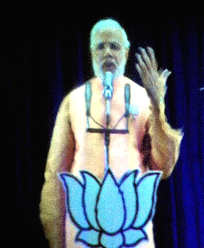 BJP Prime Ministerial candidate and Gujarat Chief Minister Narendra Modi addresses public using 3D Hologram technique at Sharan Degree College of Allahabad on April 11, 2014.