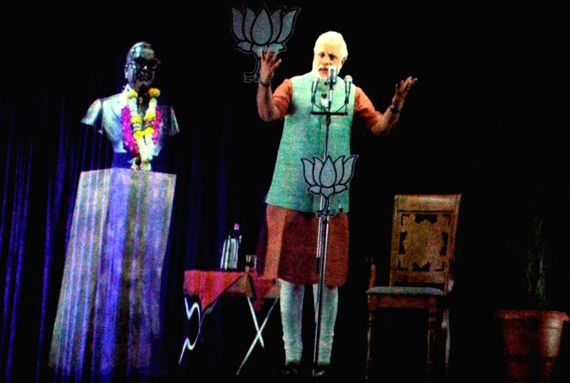 BJP Prime Ministerial candidate and Gujarat Chief Minister Narendra Modi addresses public using 3D Hologram technique at Anglo Bengali Inter College of Allahabad on April 14, 2014.