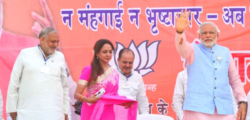BJP Prime Ministerial candidate and Gujarat Chief Minister Narendra Modi with party's candidate for upcoming 2014 Lok Sabha Election from Mathura, actress Hema Malini during a rally in Mathura on ... - Hema Malini