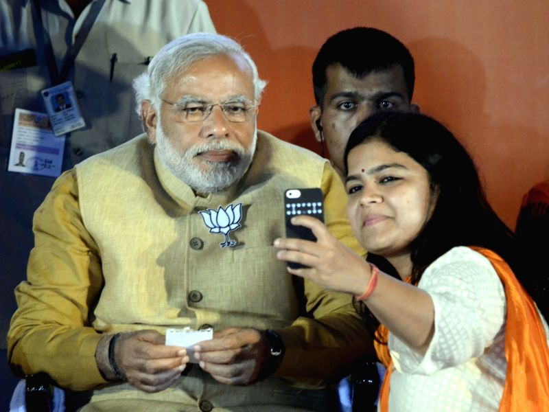 BJP Prime Ministerial candidate and Gujarat Chief Minister Narendra Modi with BJP`s candidate for upcoming 2014 General Election from North Mumbai, Poonam Mahajan during a rally at Bandra Kurla ... - Poonam Mahajan