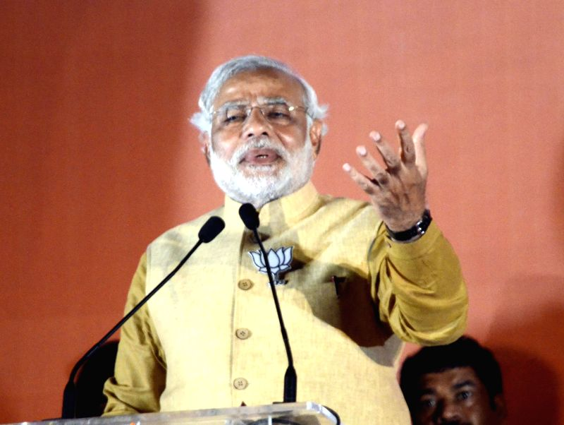 BJP Prime Ministerial candidate and Gujarat Chief Minister Narendra Modi addresses during a rally at Bandra Kurla Complex of Mumbai on April 21, 2014.