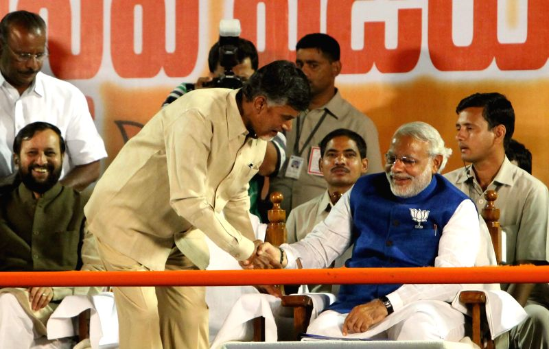 BJP Prime Ministerial candidate and Gujarat Chief Minister Narendra Modi with Telugu Desam Party (TDP) president N. Chandrababu Naidu during a rally in Hyderabad on April 22, 2014. - N. Chandrababu Naidu