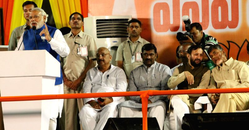 BJP Prime Ministerial candidate and Gujarat Chief Minister Narendra Modi addresses during a rally in Hyderabad on April 22, 2014.