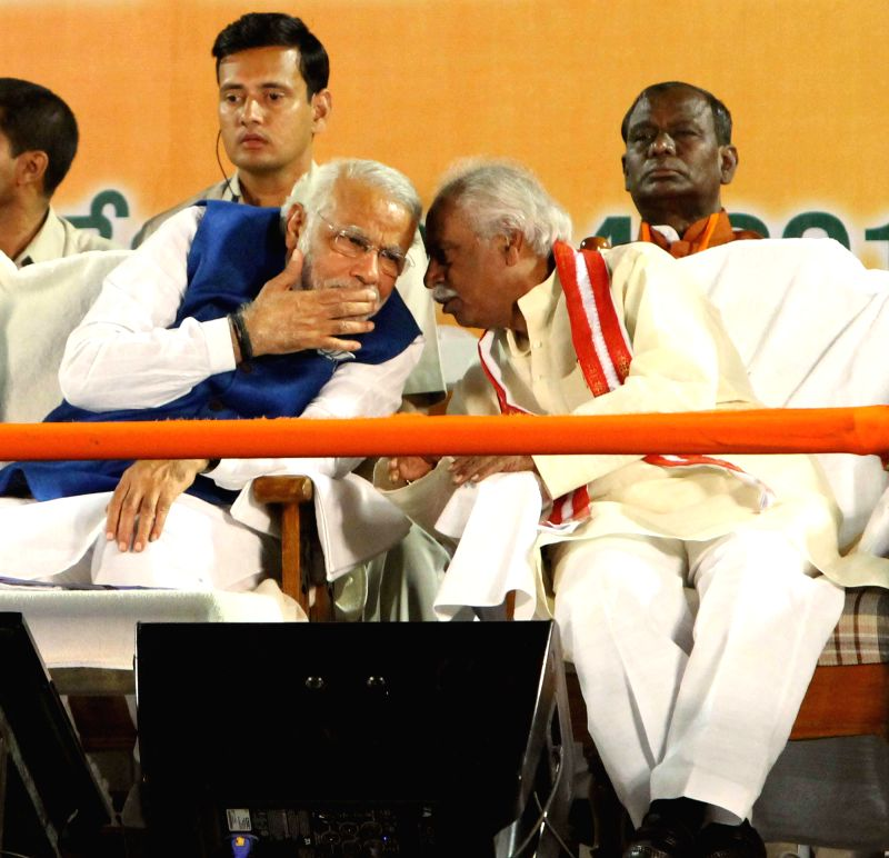 BJP Prime Ministerial candidate and Gujarat Chief Minister Narendra Modi and senior party leader Bandaru Dattatreya during a rally in Hyderabad on April 22, 2014.