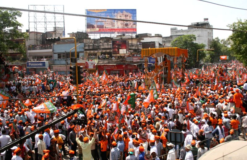 BJP Prime Ministerial candidate and Gujarat Chief Minister Narendra Modi and his supporters during a road show ahead of filing his nomination papers in Varanasi on April 24, 2014.
