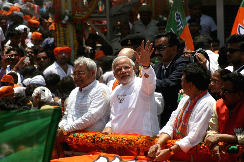 BJP Prime Ministerial candidate and Gujarat Chief Minister Narendra Modi  during a road show ahead of filing his nomination papers in Varanasi on April 24, 2014.