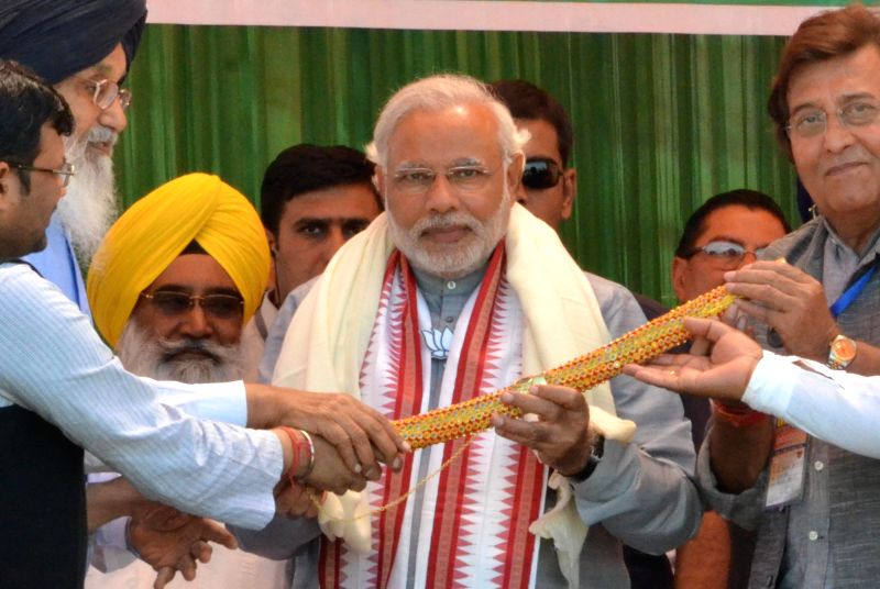 BJP Prime Ministerial candidate and Gujarat Chief Minister Narendra Modi during a rally in Pathankot of Punjab on April 25, 2014.
