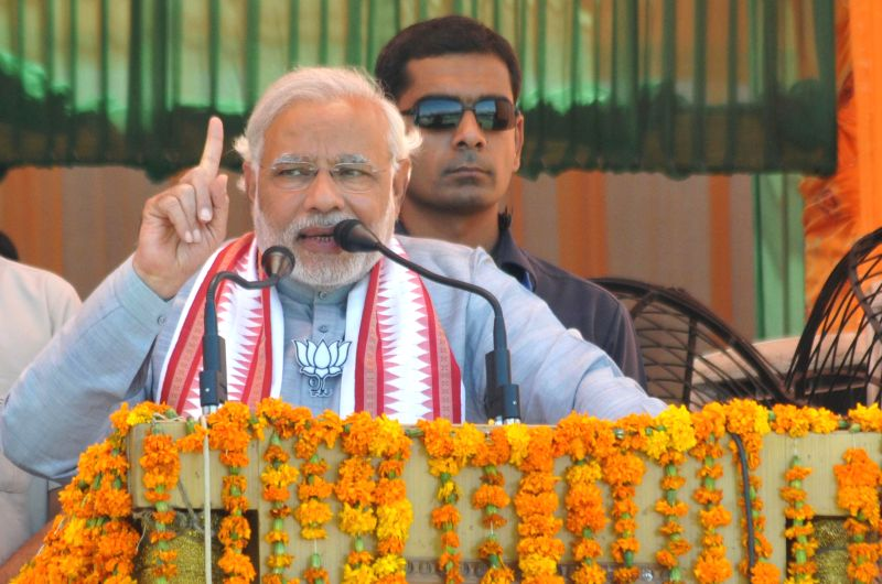 BJP Prime Ministerial candidate and Gujarat Chief Minister Narendra Modi addresses a rally in Pathankot of Punjab on April 25, 2014.