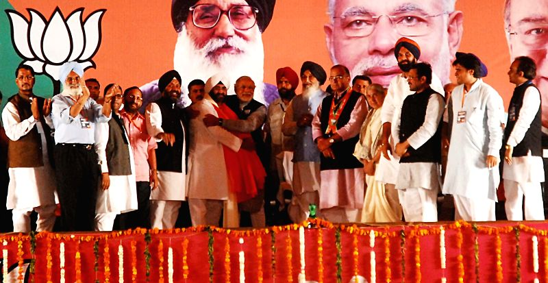BJP Prime Ministerial candidate and Gujarat Chief Minister Narendra Modi  with Punjab Chief Minister Parkash Singh Badal, party's candidate for 2014 Lok Sabha Election from Amritsar, Arun Jaitley and - Parkash Singh Badal and Arun Jaitley