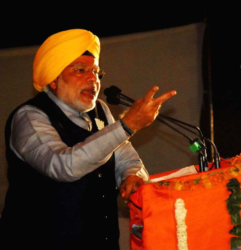 BJP Prime Ministerial candidate and Gujarat Chief Minister Narendra Modi addresses a rally in Amritsar on April 25, 2014.