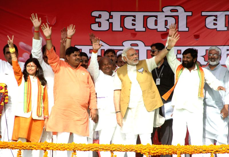 BJP Prime Ministerial candidate and Gujarat Chief Minister Narendra Modi  during a rally in Sidhauli of Uttar Pradesh on April 27, 2014.