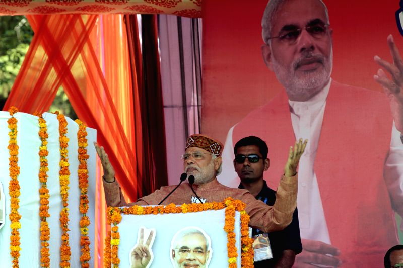 BJP Prime Ministerial candidate and Gujarat Chief Minister Narendra Modi during a rally in Palampur of Himachal Pradesh on April 29, 2014.