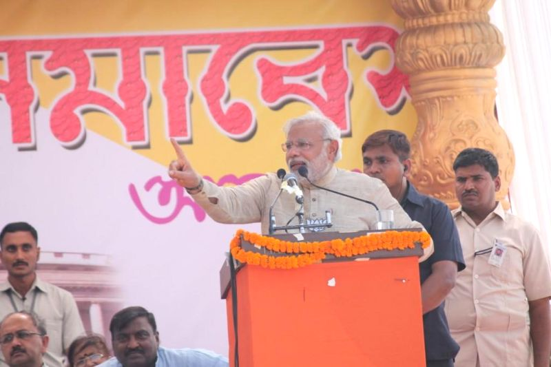 BJP Prime Ministerial candidate and Gujarat Chief Minister Narendra Modi with party's candidate for 2014 Lok Sabha Election from Asansol, singer Babul Supriyo during a rally in Asansol of West Bengal