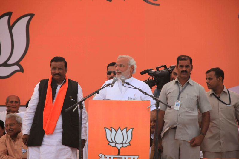 BJP Prime Ministerial candidate and Gujarat Chief Minister Narendra Modi  addresses a rally in Uttar Pradesh's Amethi on May 5, 2014.