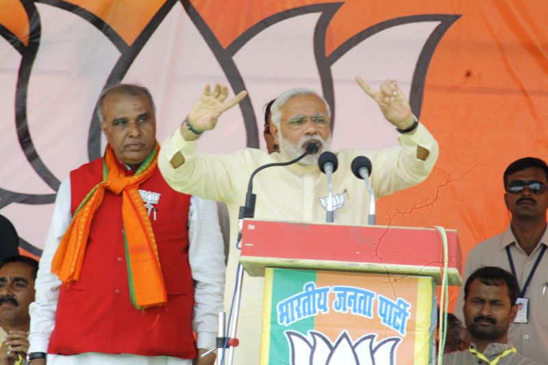 BJP Prime Ministerial candidate and Gujarat Chief Minister Narendra Modi addresses a rally in Domariyaganj of Uttar Pradesh on May 6, 2014.