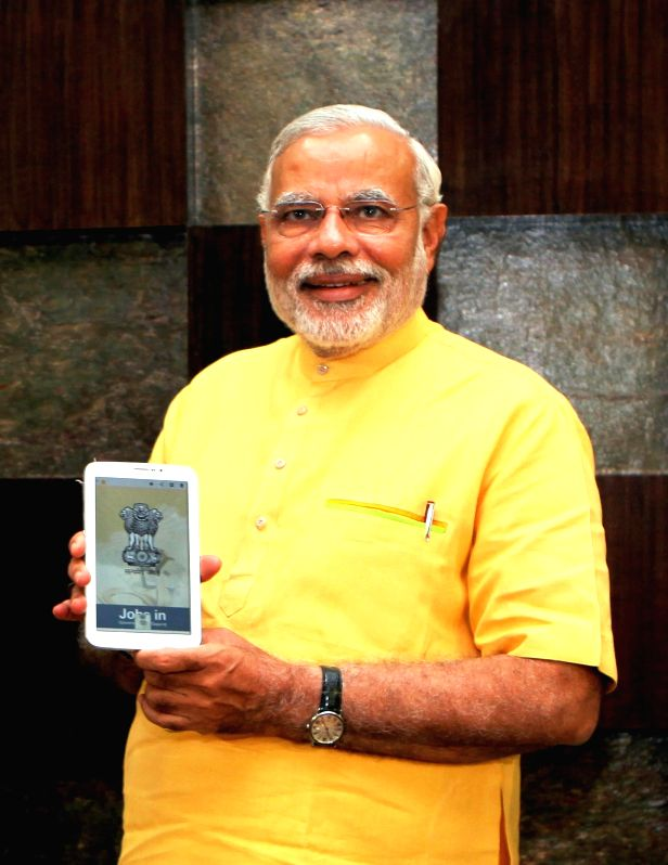 BJP Prime Ministerial candidate and Gujarat Chief Minister Narendra Modi launches 'JOBS IN' - mobile application for Government Jobs in Gandhinagar on May 15, 2014.