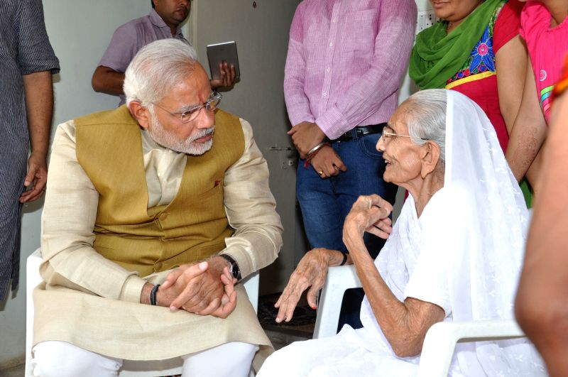 BJP Prime Ministerial candidate and Gujarat Chief Minister Narendra Modi with his mother before declaration of 2014 Lok Sabha Election results at his brother's house in Gandhinagar on May 16, 2014.