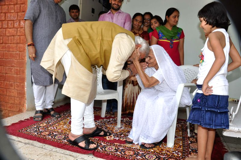 BJP Prime Ministerial candidate and Gujarat Chief Minister Narendra Modi seeks his mothers blessings before declaration of 2014 Lok Sabha Election results at his brother's house in Gandhinagar on May