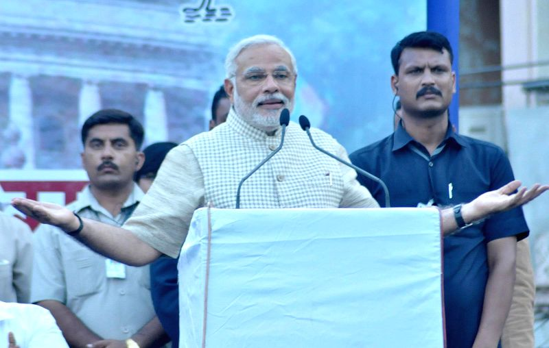 BJP Prime Ministerial candidate and Gujarat Chief Minister Narendra Modi addresses a public meeting after winning Vadodara Lok Sabha seat in the city on May 16, 2014.