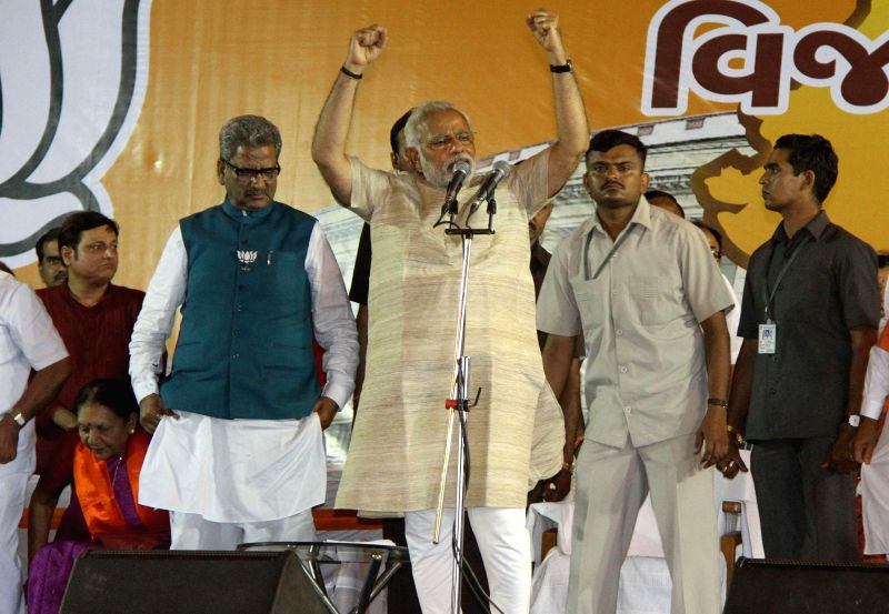 BJP Prime Ministerial candidate and Gujarat Chief Minister Narendra Modi addresses a public rally in Ahmedabad on May 16, 2014.