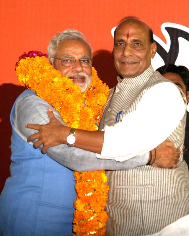 BJP Prime Ministerial candidate Narendra Modi with party president Rajnath Singh during a press conference in New Delhi on May 17, 2014. - Narendra Modi and Rajnath Singh