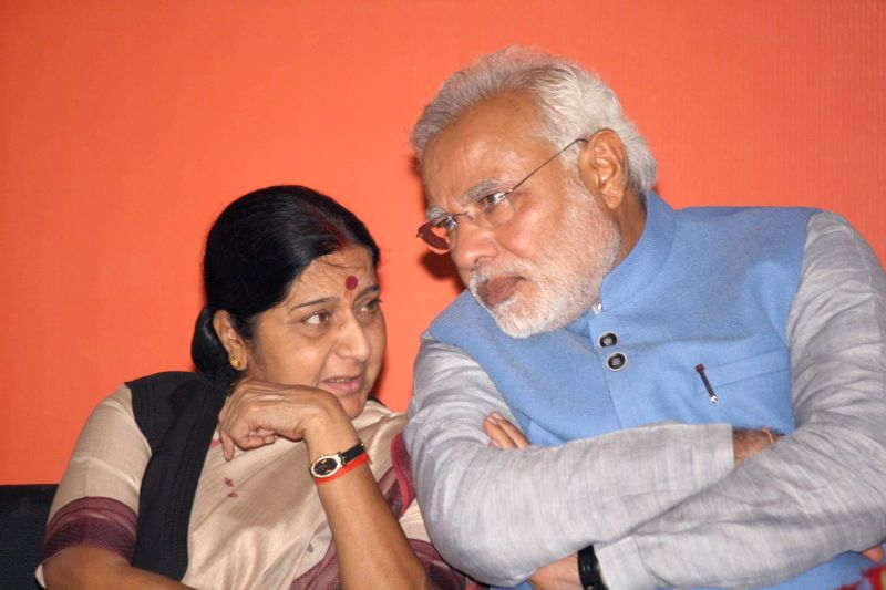 BJP Prime Ministerial candidate Narendra Modi with party leader Sushma Swaraj during a press conference in New Delhi on May 17, 2014. - Narendra Modi and Sushma Swaraj