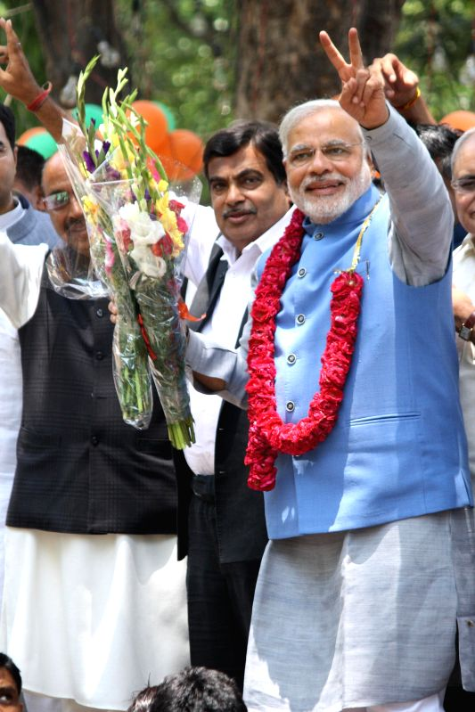 BJP Prime Ministerial candidate Narendra Modi with party leader Vijay Goel, Nitin Gadkari and others at party headquarters in New Delhi on May 17, 2014.