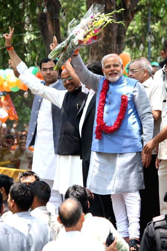 BJP Prime Ministerial candidate Narendra Modi with party leader Vijay Goel, and others at party headquarters in New Delhi on May 17, 2014.