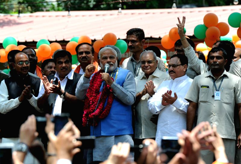 BJP Prime Ministerial candidate Narendra Modi addresses party workers at BJP headquarters in New Delhi on May 17, 2014.